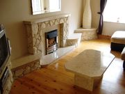 STONE FIREPLACE AND TABLE.JPG